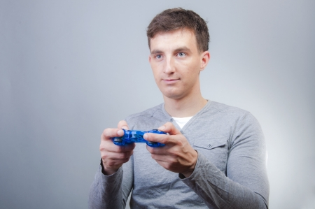 An image of boy holding joystick and playing games  photo