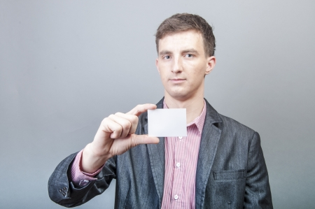 An image of businessmen holding blank card photo