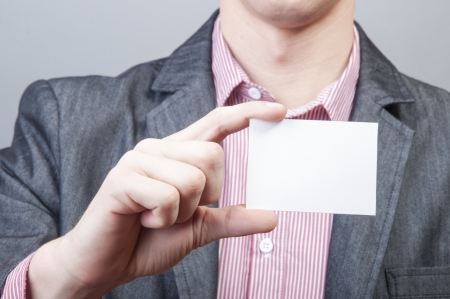 An image of businessmen holding blank card Stock Photo - 17287740