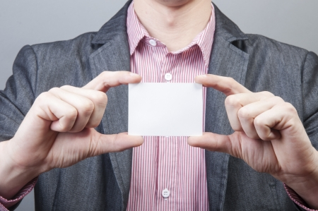 An image of businessmen holding blank card Stock Photo - 17287701
