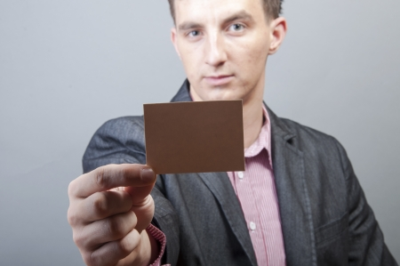 An image of businessmen holding blank card Stock Photo - 17287453