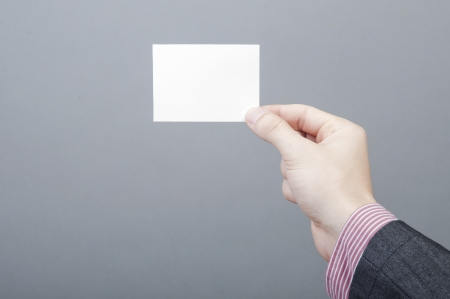 An image of businessmen holding blank card Stock Photo - 17287445