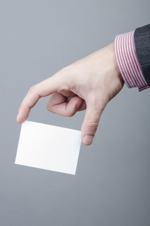 An image of businessmen holding blank card Stock Photo - 17287449