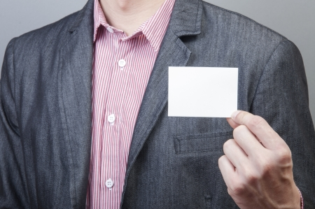 An image of businessmen holding blank card Stock Photo - 17287622