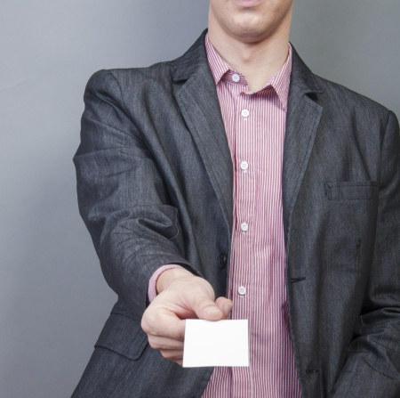 An image of businessmen holding blank card Stock Photo - 17287775