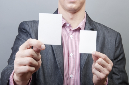 An image of businessmen holding blank card Stock Photo - 17287732