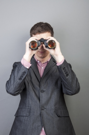An image of businessmen looking through binocular