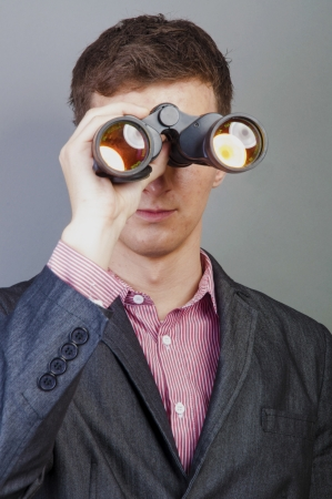 An image of businessmen looking through binocular photo