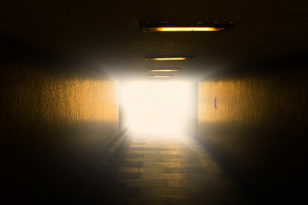An image of bright light at the end of tunnel photo