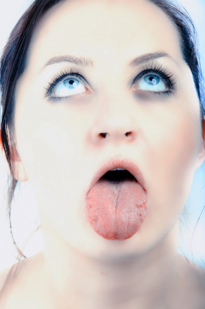 an image of sick women showing her tongue photo