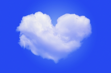 An image of heart shaped cloud on blue  photo