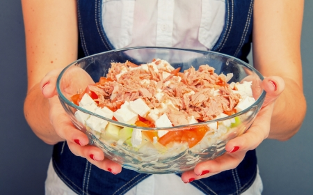 An image of girl holding tuna salad in salad bowl photo