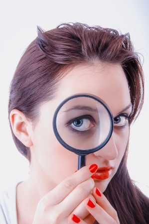 An image of Women with magnifying glass over her lips photo