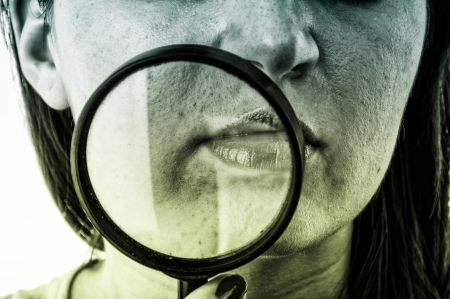An image of women with skin problem holding magnifying glass over her face Stock Photo - 17449417