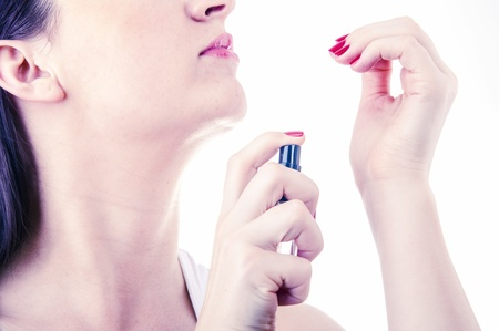 An image of woman testing perfume isolated on white Standard-Bild