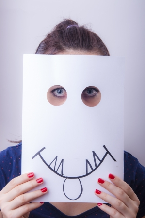 An image of businesswoman holding paper with drown emotions