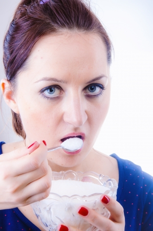An image of woman eating sugar photo