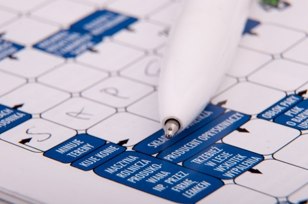 puzzling: An image of crossword and white pen Stock Photo