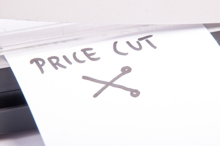 An image of price cuts with guillotine Stock Photo - 17607626