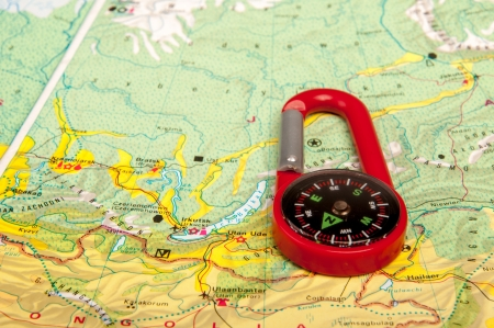 An image of red pocket compass and road map photo