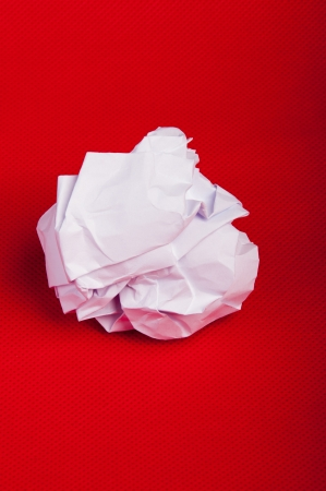 An image of paper rubbish isolated on red background photo