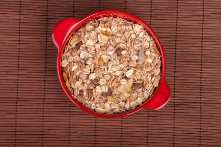 An image of hewalthy muesli in red ceramic bowl Stock Photo - 17611077