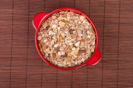 An image of hewalthy muesli in red ceramic bowl photo