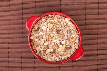 An image of hewalthy muesli in red ceramic bowl Stock Photo - 17611073