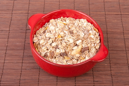 An image of hewalthy muesli in red ceramic bowl Stock Photo - 17610995