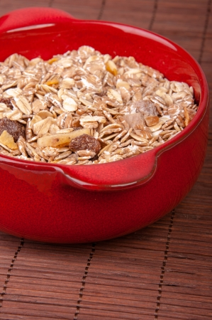 An image of hewalthy muesli in red ceramic bowl Stock Photo - 17607737