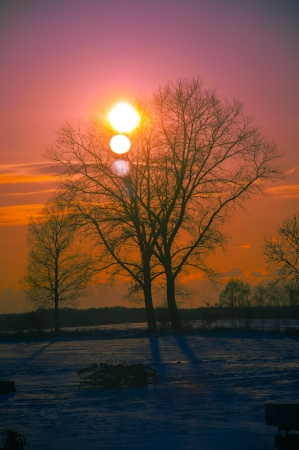 An image of sunset in winter scenery photo