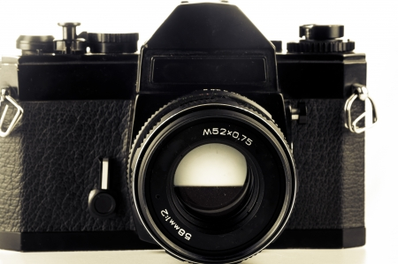 An image of old analog camera on white photo