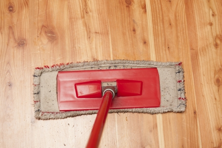 An image of red dwile and wooden floor