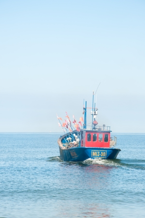 Fishing boat comes to fishing