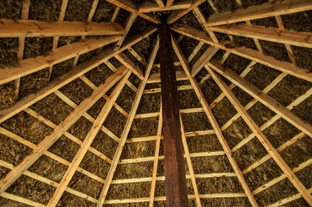 Wooden roof construction in the house photo