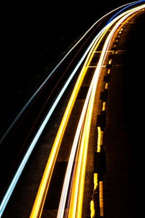 An image of Car lights on a highway at night photo