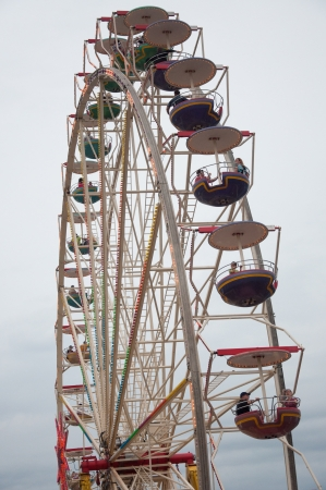SZCZECIN - AUGUST 04: Visitors on Ferris Wheel during the final of The Tall Ships Races 2013 in Szczecin, August 04, 2013 in Szczecin, Poland.
