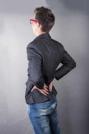 an image of young businessman with back pain photo