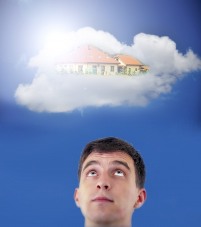 Young adult dreaming about new house in the sky photo