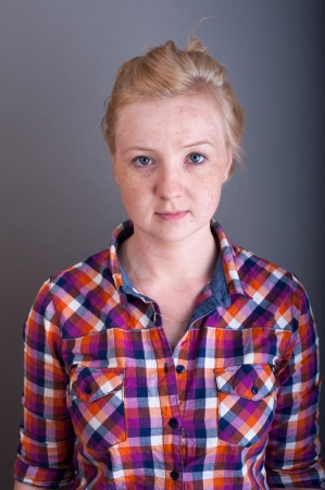 An image of Studio portrait of freckled blonde Stock Photo