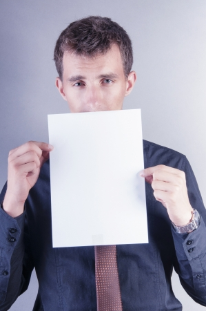 an image of young handsome businessman with blank card photo