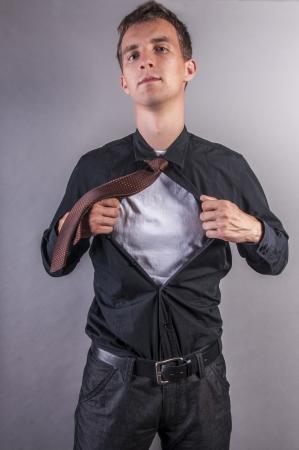 strips away: an image of young businessman pulls shirt