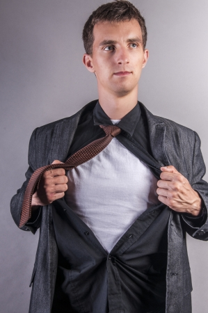rips: an image of young businessman pulls shirt