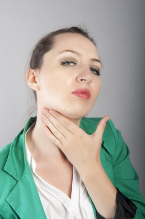 sore throat: an image of businesswoman with sore throat