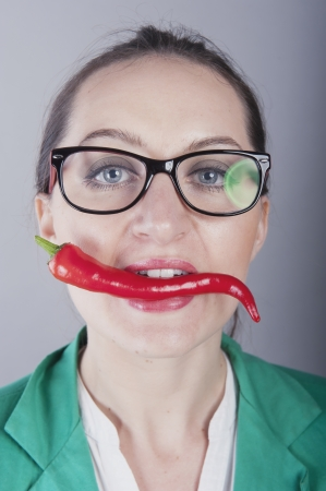 an image of businesswoman holding red chilli pepper photo