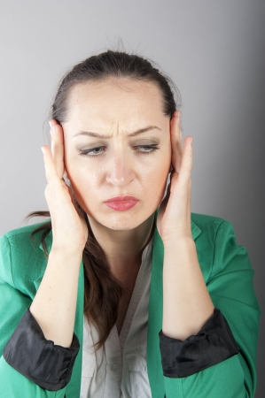 an image of businesswoman with headache  photo