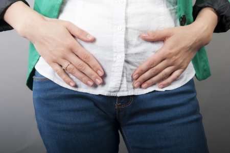 an image of Businesswoman with abdominal pains