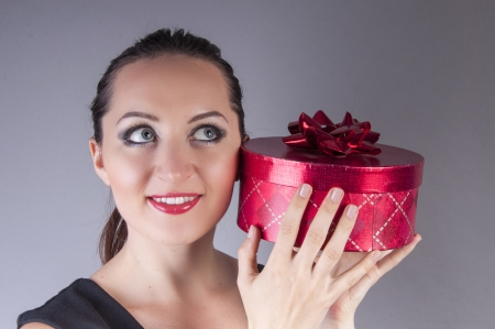 an image girl holding red gift box Stock Photo - 22673733