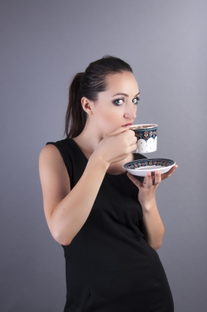 an image of businesswoman drink coffee Stock Photo - 22673771