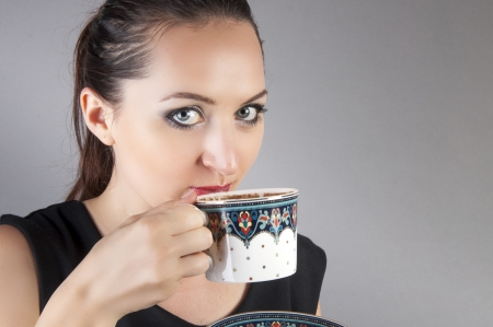 an image of businesswoman drink coffee photo